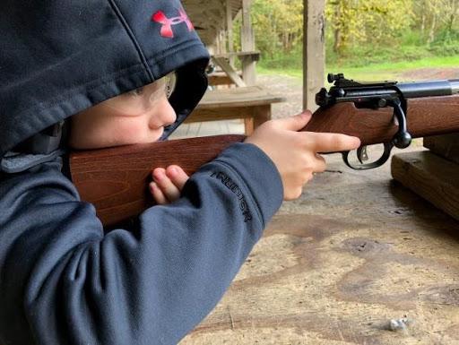 Kid shooting gun